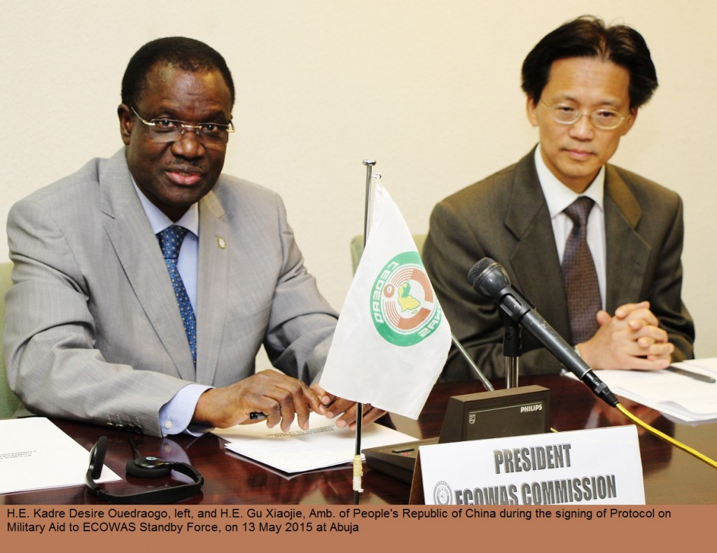 H.E. Kadre Desire Ouedraogo, left, making statement and H.E. Gu Xiaojie, Amb. of People's Republic of China during Signing of Protocol on Military Aid Gratis to ECOWAS, 13 May 2015 IMS90