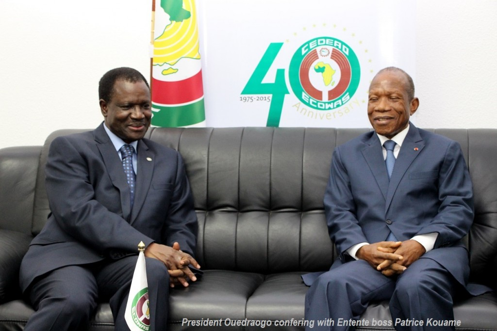 President Ouedraogo confering with Entente boss Patrice Kouame