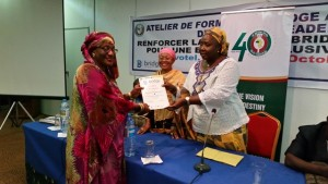 Fatimata Fafa Balde receiving her BRIDGE certicate from Mme Sylla after the training