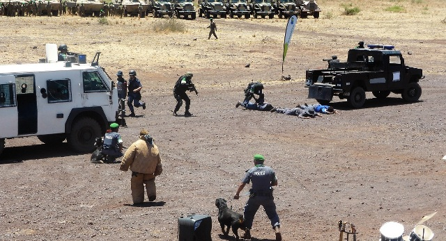 Members of the Amani Africa II Police component demonstrating  riot control skills edited