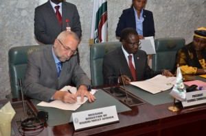 USAID West Africa Director with Ecowas President Signing the agreement