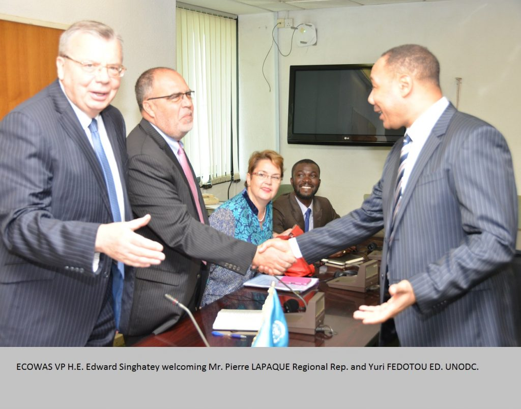 right. VP ECOWAS Commission shaking hands with Pierre LAPAQUE Regional Rep. and Yuri FEDOTOU ED. UNODC