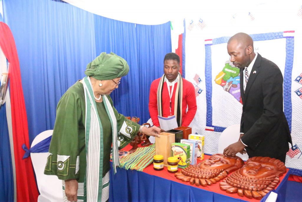 President Sirleaf views Made in Liberia Products at a Trade fair in Nairobi as Dep. Commerce Minister - Steve Marvie looks on