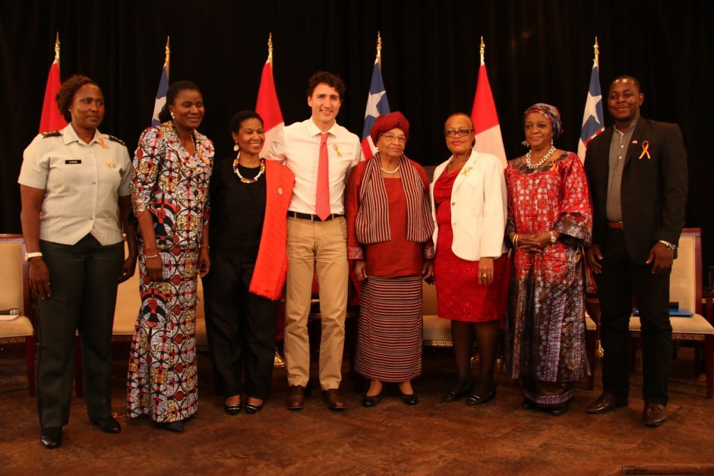 panelists-in-a-group-picture-with-pres-sirleaf-and-pm-trudeau
